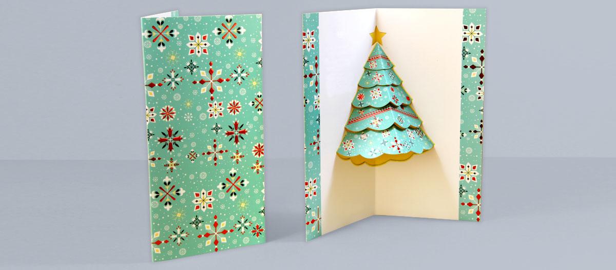 Tarjeta navideña con un diseño de un árbol de Navidad que es un elemento pop up