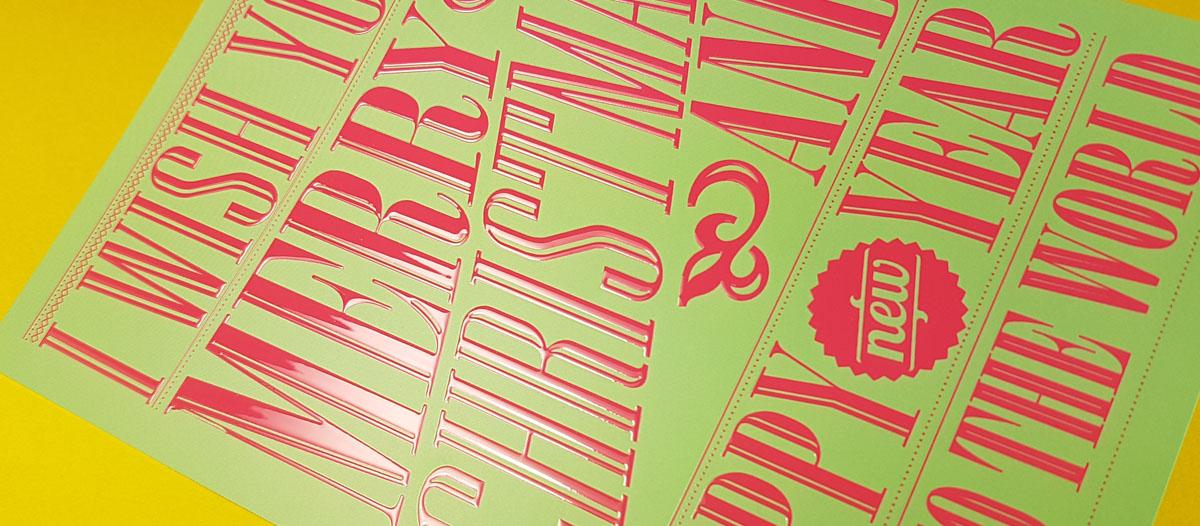 Felicitación de Navidad con tipografías sobre las que se ha aplicado un barniz digital 3D